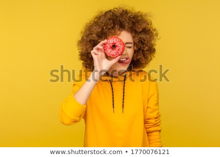 Funny girl playing with confection Stock photo © deandrobot