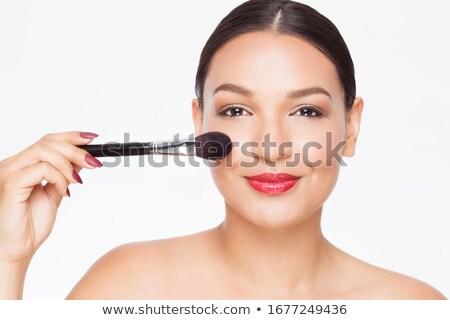 Model applying makeup Stock photo © artfotodima