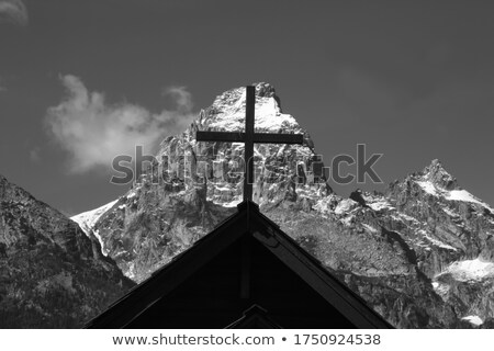 Christianity religious cross on snow capped mountain Stock photo © stevanovicigor