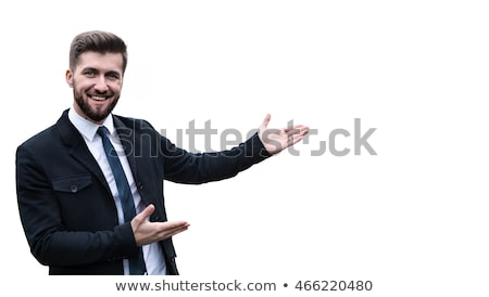 Handsome young businessman presenting something Stock photo © gsermek