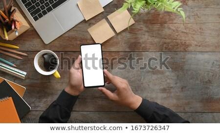 Laptop kawa czarna telefonu komórkowego dziennik drewniany stół Zdjęcia stock © wavebreak_media