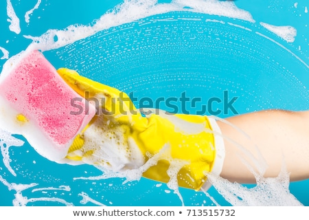 hand cleaning glass window pane with detergent and wipe or sponge Stock photo © OleksandrO