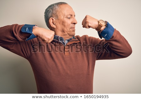 strong man showing muscles stock photo © LightFieldStudios
