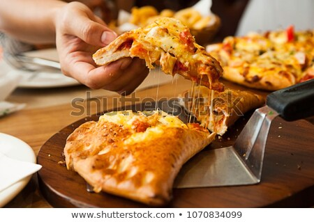Puff-pizza with mozzarella cheese, tomatoes on plate Stock photo © Virgin