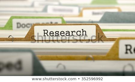 Surveys on Business Folder in Catalog. Stock photo © tashatuvango