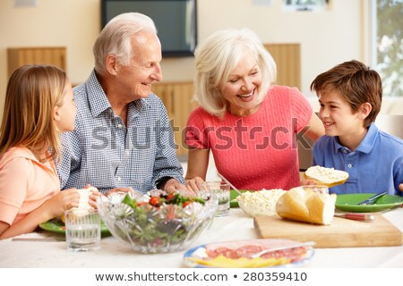 grandson and grandfather eating Stock photo © IS2