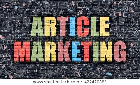 Stock photo: Article Marketing on Dark Brick Wall.