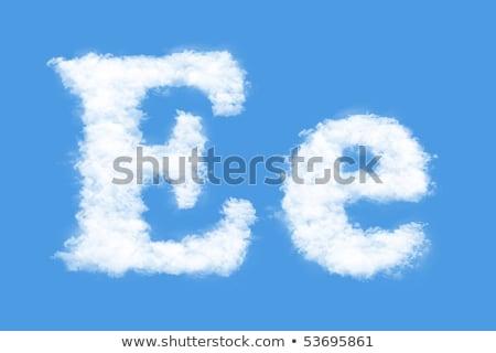 Letter E cloud font symbol. White Alphabet sign on blue sky Stock photo © popaukropa