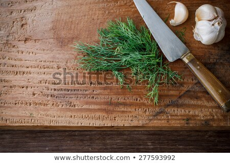 Fresh organic dill for cook put on wooden cutting board with knife Stock photo © Virgin