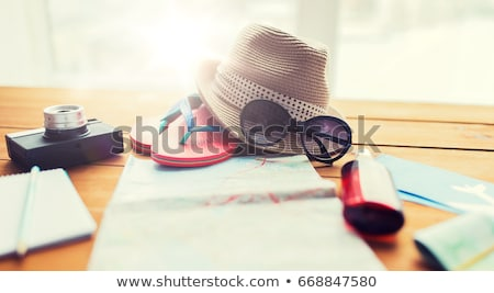 close up of notepad with map and travel tickets Stock photo © dolgachov