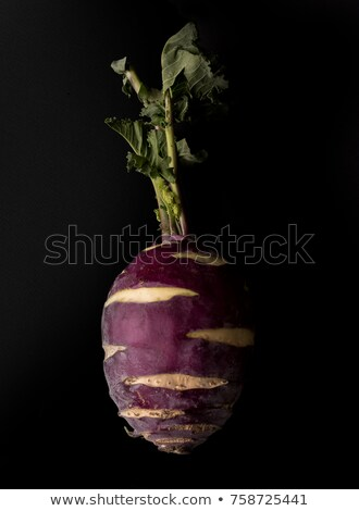 Close up of fresh red radish isolated over black Stock photo © deandrobot