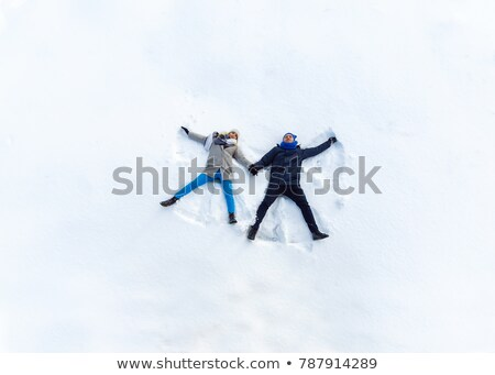Young boy lying in snow Stock photo © IS2
