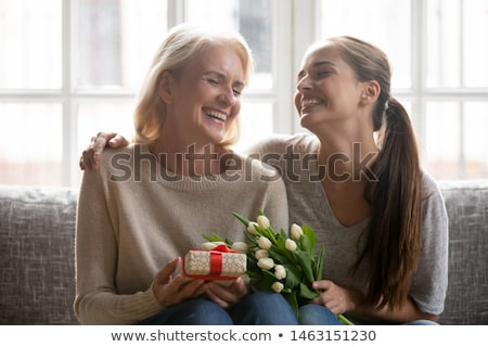 Two Senior Adult Women sitting on sofa Stock photo © IS2