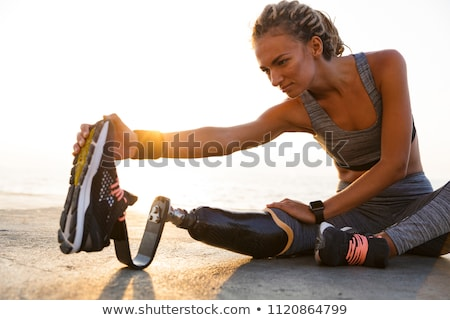Image of disabled athletic girl in sportswear, doing sports and  Stock photo © deandrobot