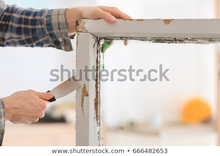 Stock photo: Old putty knife at grunge window