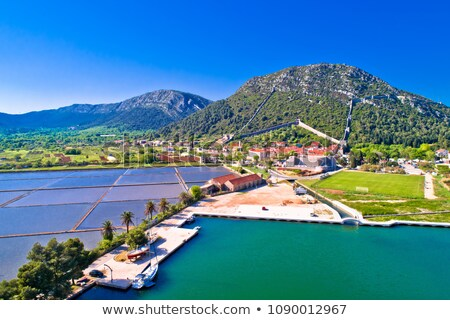 Ston salt fields and turquoise harbor aerial view Stock photo © xbrchx