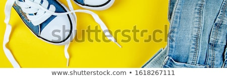 Blue female or male jeans, denim on yellow paper background. Stock photo © Illia