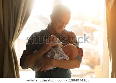 Apa etetés baba lánygyermek üveg otthon Stock fotó © dolgachov