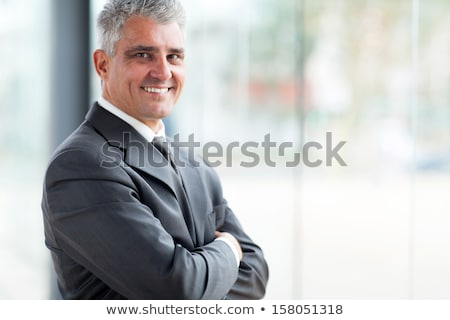 Senior businessman with folded arms indoors Stock photo © Giulio_Fornasar