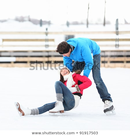 ice skating couple having winter fun on ice skates quebec canada stock photo © lopolo