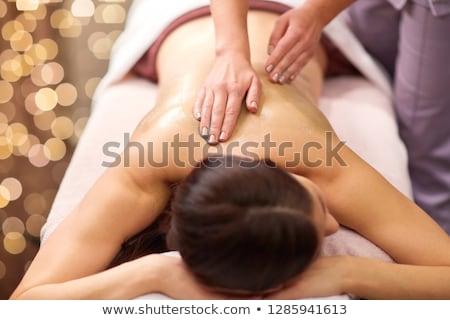 Mulher de volta massagem gel estância termal pessoas Foto stock © dolgachov