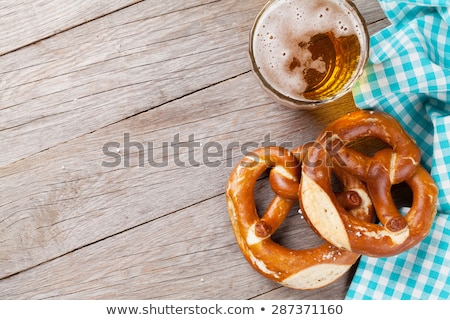 Oktoberfest backdrop. Pretzels and beer mug Stock photo © karandaev