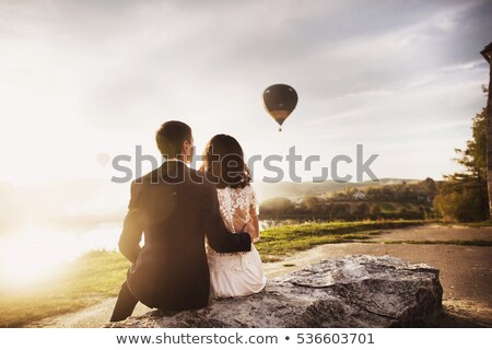 Just-married couple on the sunset background. Love is in the air Stock photo © ruslanshramko
