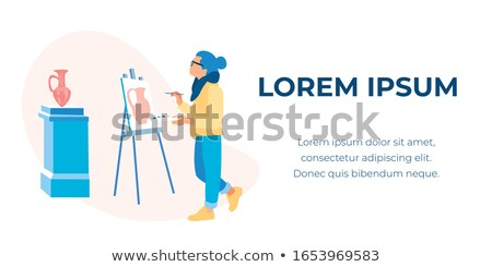 Inspired man with palette and paintbrush standing in front of easel and painting Stock photo © pressmaster