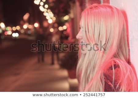 beautifull girl with red light on the street. Stock photo © Lopolo