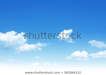 Bright white clouds in a blue clear sky. Stock photo © artjazz