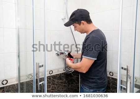 Plumber Fixing Faucet In Shower Stock photo © AndreyPopov