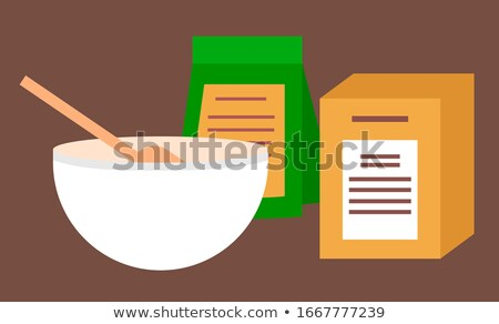 Mixing Bowl with Wooden Spoon and Packs of Flour Stock photo © robuart