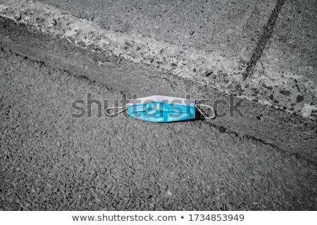 Utilizado mascarilla quirúrgica asfalto primer plano azul carretera Foto stock © nito