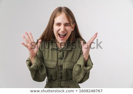 Photo agacé jeune femme hurlant caméra Photo stock © deandrobot