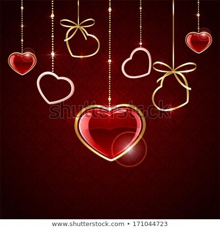 Ruby oro cuore luce impiccagione grigio Foto d'archivio © nurrka