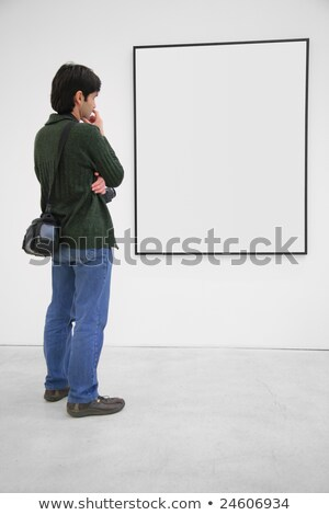 Visitor looks on frame in showroom Stock photo © Paha_L