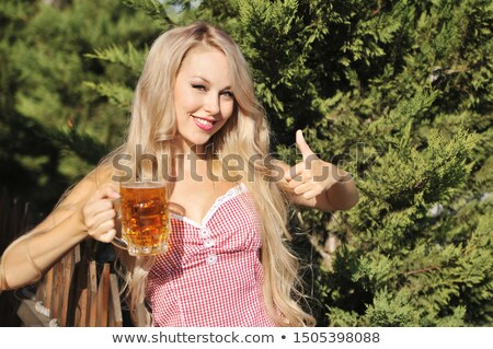 pretty bavarian girl with a glass of beer stock photo © rob_stark