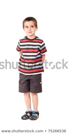 Huncut kicsi fiú néz kívül izolált Stock fotó © pekour