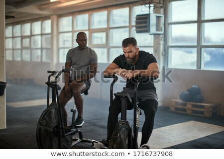 two young people resting on cardio machines Stock photo © photography33