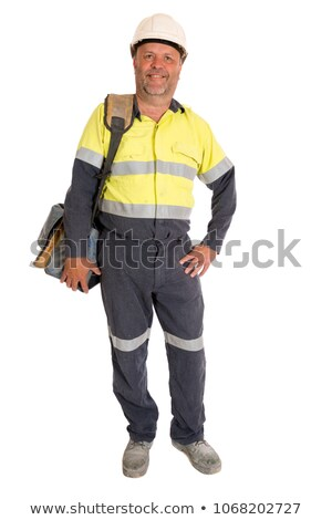 Stock photo: Tradesman posing for the camera with his tools