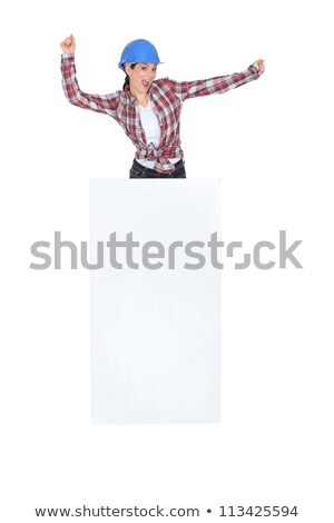 Enthusiastic construction worker with a board left blank for your message Stock photo © photography33