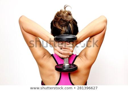 Fit woman lifting dumbbells stock photo © stryjek
