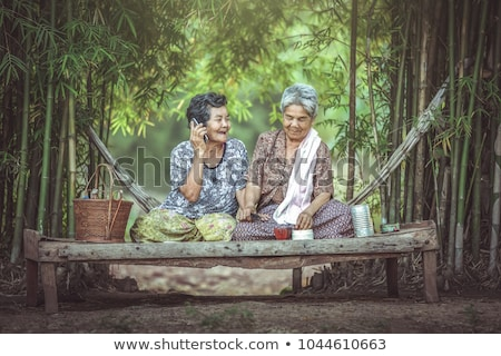 couple sat in the park with laptop stock photo © photography33