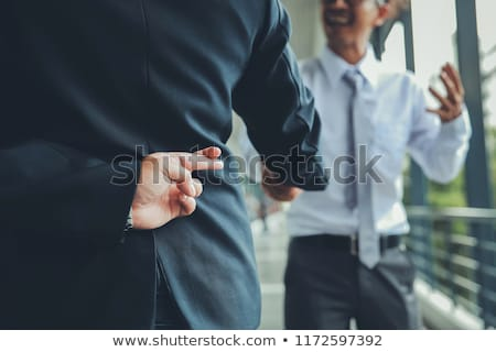 business man with fingers crossed behind back Stock photo © feedough