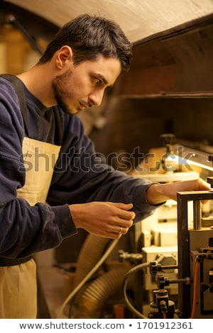 male carpenter sawing stock photo © photography33