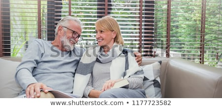 Portrait of a happy couple outdoors on a winter's day Stock photo © photography33