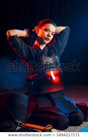 Portrait of a girl wearing kendo uniform stock photo © zzve