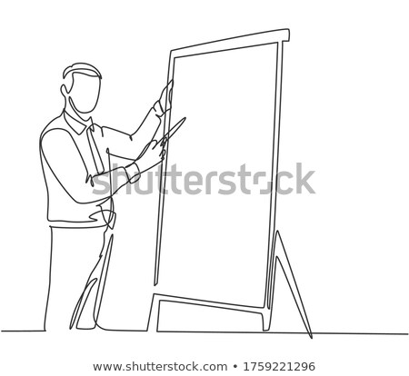 Man writing on flip chart Stock photo © photography33