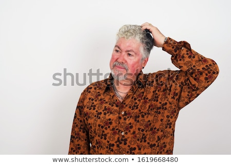 mature frightened against blue background Stock photo © photography33