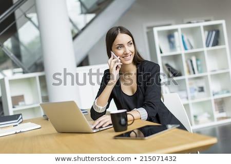 улыбающаяся женщина ноутбук карандашом улыбка работник жизни Сток-фото © photography33